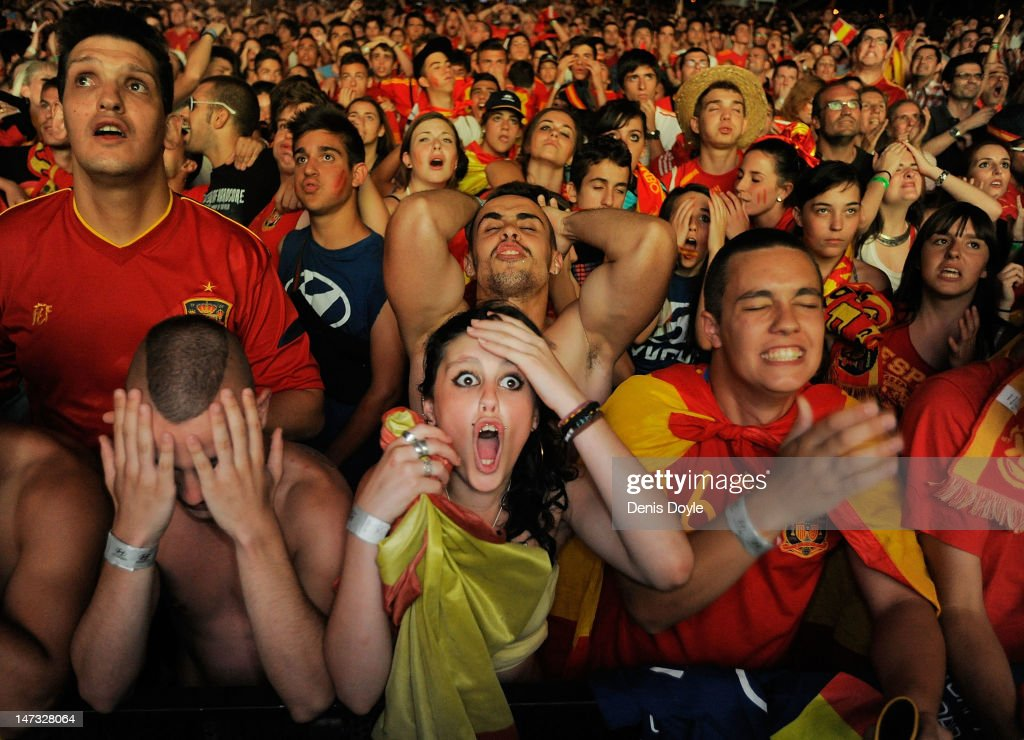 Spanish fans react while watching on a giant outdoor screen on Paseo de La Castellana street the UEFA EURO 2012 semi-final match between Spain and Portugal on June 27, 2012 in Madrid, Spain.