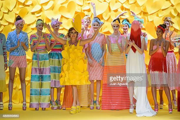 Spanish fashion designer Agatha Ruiz de la Prada salutes on the runway at the Agatha Ruiz de la Prada show during MercedesBenz Fashion Week Madrid...
