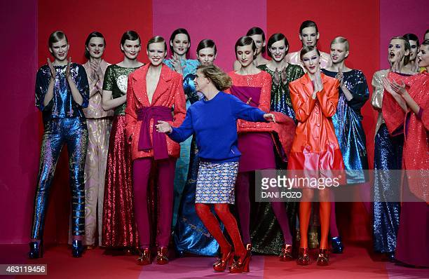 Spanish fashion designer Agatha Ruiz is applauded by her models at the end of the presentation of the Ana Locking AutumnWinter collection during...