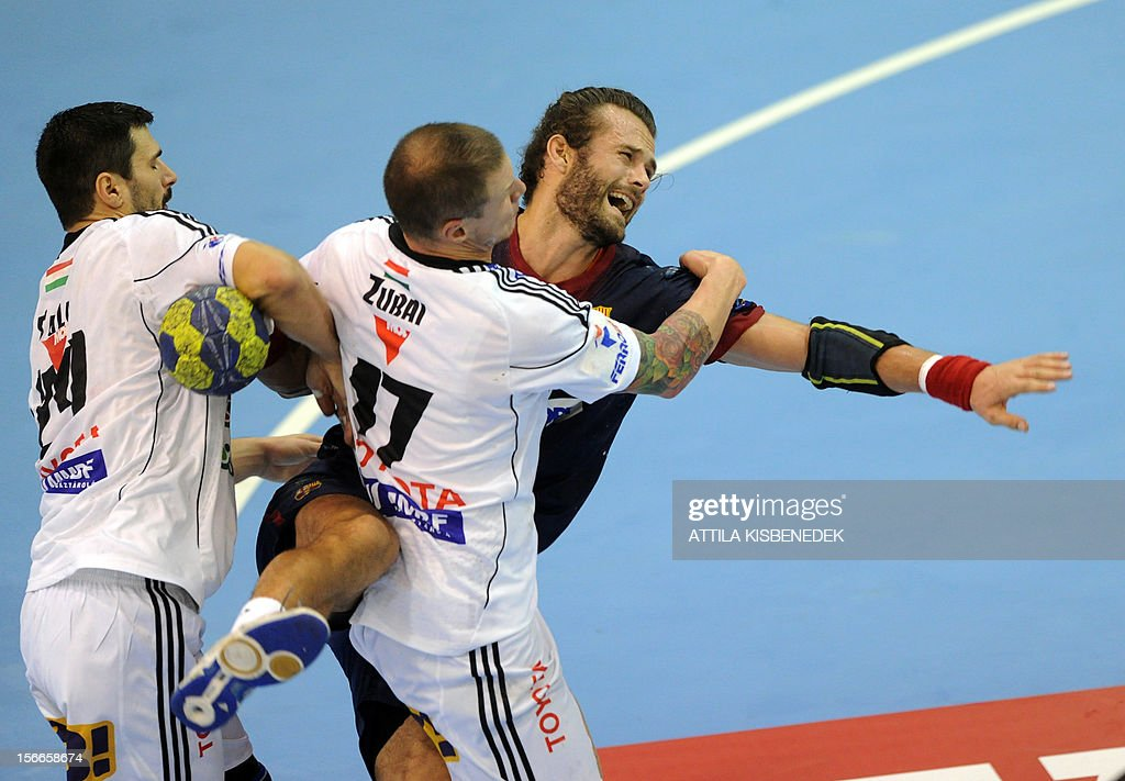 Spanish FC Barcelona's Danish Jesper Noddesbo (R) is fould by Hungarian Szabolcs Zubai (C) of PICK-Szeged and Slovakian Frantisek Sulc (L) on November 18, 2012 in Szeged during their EHF Champions League match.