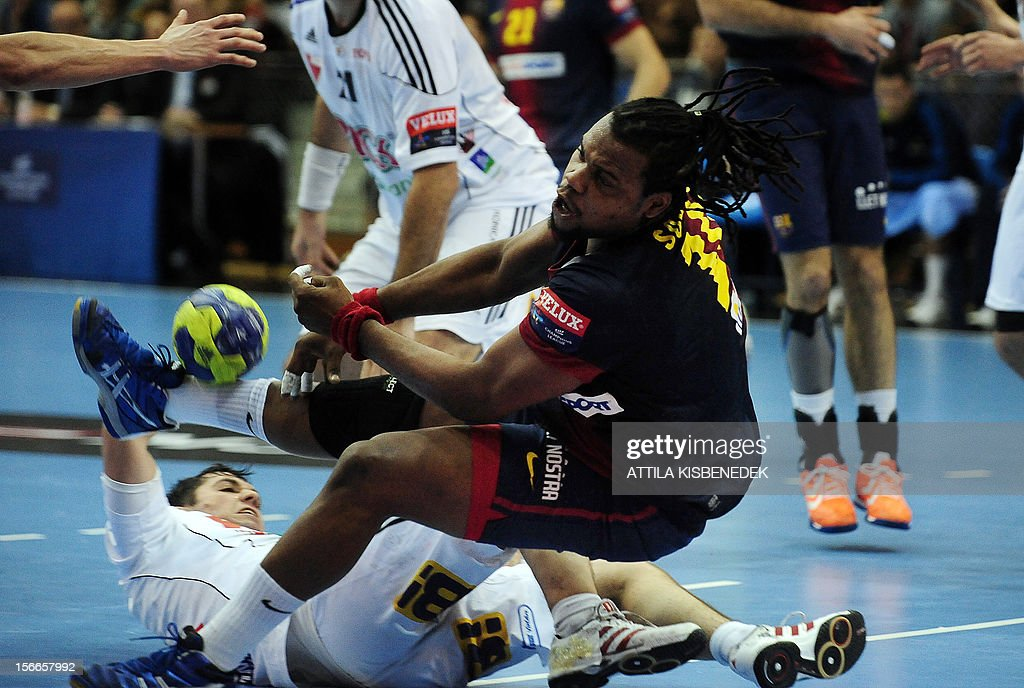 Spanish FC Barcelona's French Cedric Sorhaindo (C) fights for the ball with Hungarian defenders on November 18, 2012 in Szeged during their EHF Champions League match.