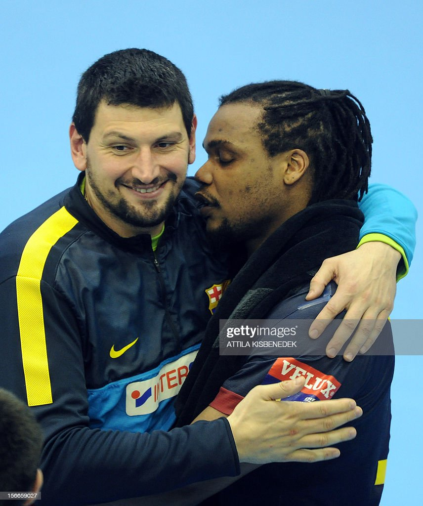 Spanish FC Barcelona's goalkeeper Arpad Sterbik (L) and French Cedric Sorhaindo (R) celebrate their victory over Hungarian PICK Szeged in the local sport hall of Szeged on November 18, 2012 after their EHF Champions League match. Barcelona won 33-28. AFP PHOTO / ATTILA KISBENEDEK