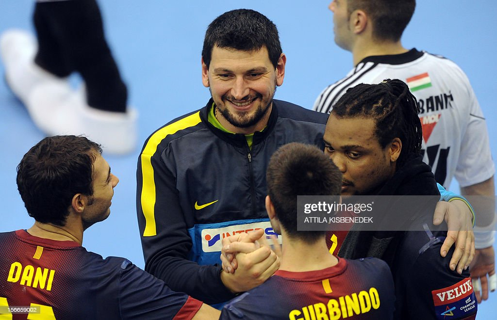 Spanish FC Barcelona's players celebrate after their victory against Hungarian PICK Szeged in the local sport hall of Szeged on November 18, 2012 after their EHF Champions League match. Barcelona won 33-28.