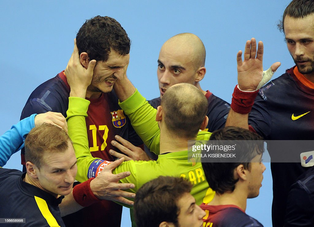 Spanish FC Barcelona's players celebrate their victory against Hungarian PICK Szeged in the local sport hall of Szeged on November 18, 2012 after their EHF Champions League match. Barcelona won 33-28.