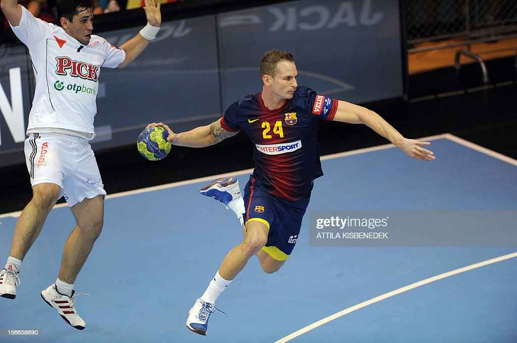 Spanish FC Barcelona's Slovak Martin Stranovsky (R) scores a goal against Hungarian Attila Vadkerti (L) of PICK-Szeged on November 18, 2012 in Szeged during their EHF Champions League match.