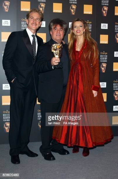 Spanish film director Pedro Almodovar flanked by Matthew Modine and Natascha McElhone after they presented him with his award for Best Original...