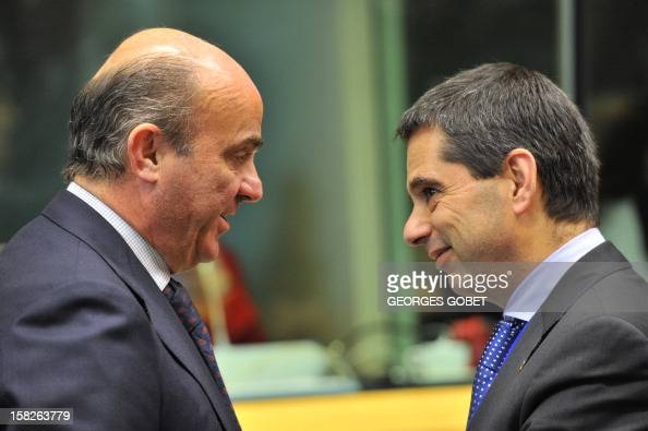 Spanish Finance Minister Luis De Guindos and Portuguese Finance Minister Vitor Gaspar talk prior an ECOFIN Council on December 12 2012 at the EU...