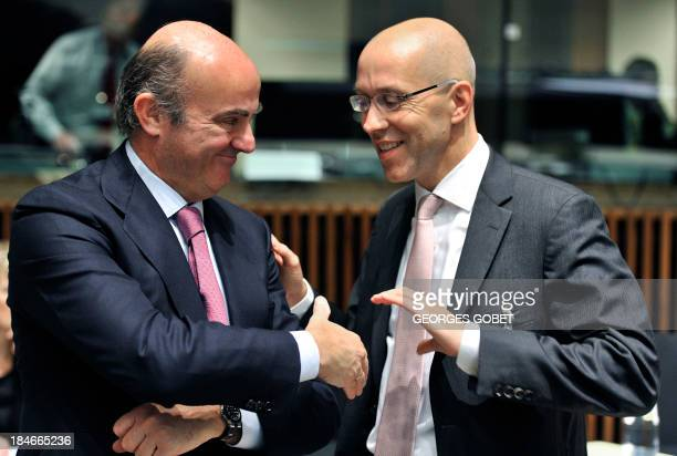 Spanish Finance Minister Luis De Guindos Jurado chats with ECB board member Jorg Asmussen prior to an European Free Trade Association at an Economic...