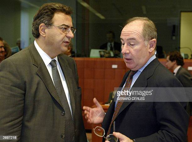 Spanish Finance minister Rodrigo Rato chats with Greek counterpart Nikkos Christodoulakis prior a working session of ECOFIN meeting at the EU...