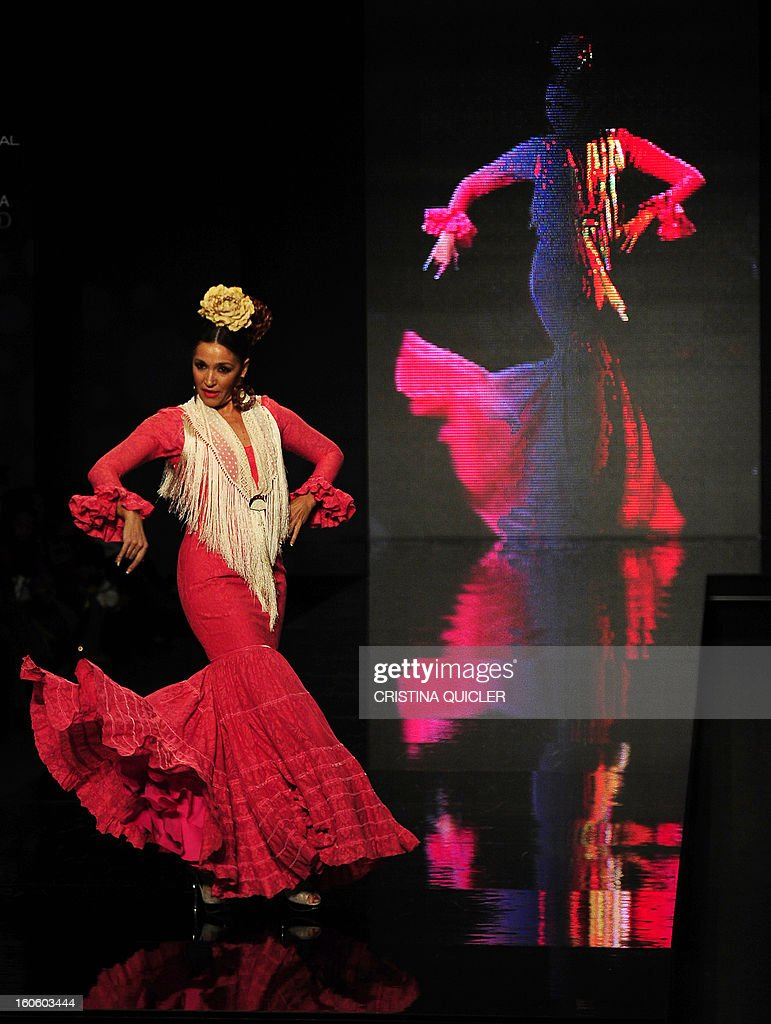 Spanish flamenco dancer Lalo Tejada presents a creation by Hermanas Serrano during the last day of the SIMOF (International Flamenco Fashion Show) in Sevilla, on February 3, 2013.