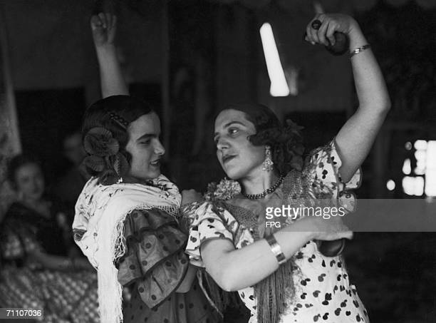 Spanish flamenco dancers performing with castanets circa 1925