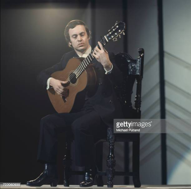 Spanish flamenco guitarist Paco Pena performs on a BBC television show in London in 1970