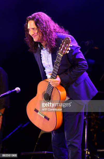 Spanish flamenco guitarist Tomatito performs during the 'Breaking the Silence' benefit concert to help flamenco singer Remedios Amaya at the Rocio...