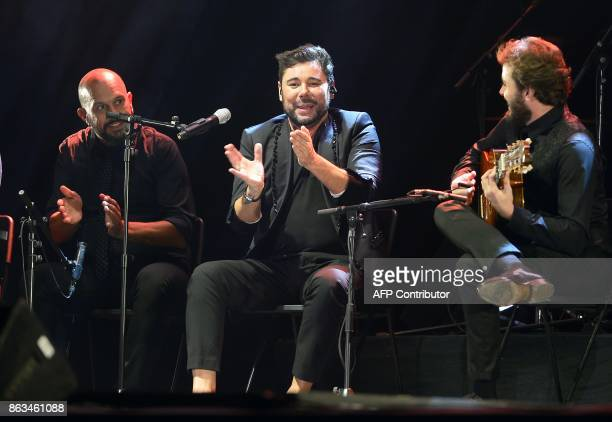 Spanish flamenco singer Miguel Poveda performs during the 'Breaking the Silence' benefit concert to help flamenco singer Remedios Amaya at the Rocio...