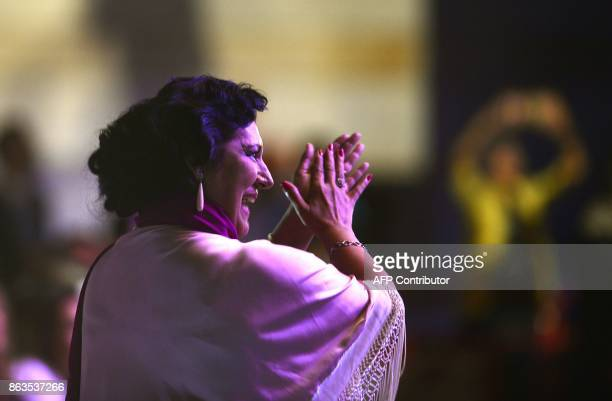 Spanish flamenco singer Remedios Amaya applauds as she attends the 'Breaking the Silence' benefit concert in her honour at the Rocio Jurado...