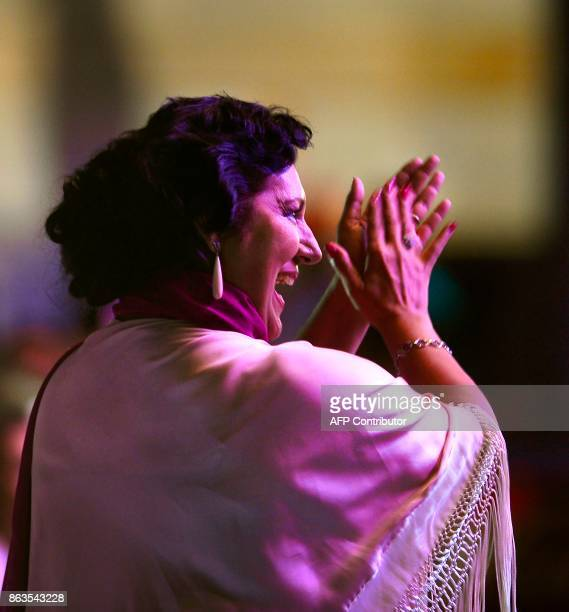 Spanish flamenco singer Remedios Amaya claps and dances as she attends the 'Breaking the Silence' benefit concert in her honour at the Rocio Jurado...
