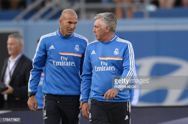 Spanish football club Real Madrid's Italian coach Carlo Ancelotti and his assistant Zinedine Zidane of France leave the pitch after the International...