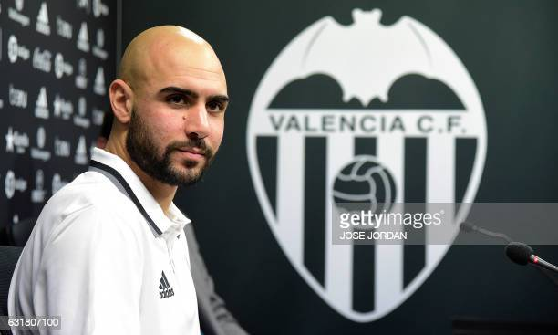Spanish football club Valencia CF's new signing Italian striker Simone Zaza poses during his official presentation at the Valencia Sports City in...