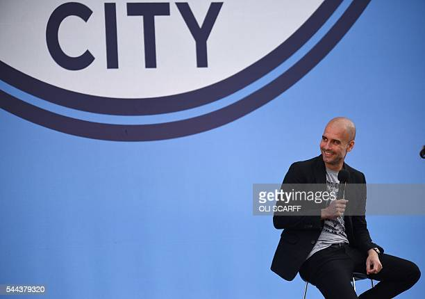 TOPSHOT Spanish football manager Pep Guardiola speaks to Manchester City fans as he is officially unveiled as the club's new manager at the City...