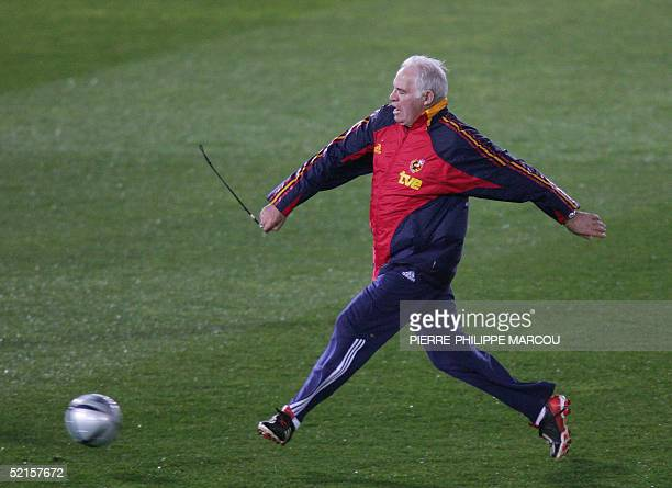 Spanish football national team's Coach Luis Aragones kicks the ball during a training session in Almeria 08 February 2005 on their eve of their World...