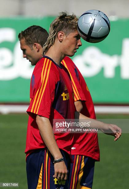 Spanish football player Fernando Torres heads a ball during a training session with the national team in Las Rozas near Madrid in preparation for the...