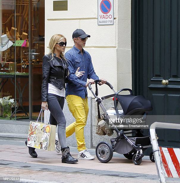Spanish football player Jose Maria Gutierrez 'Guti' argentinian Tv presenter Romina Belluscio and their son Enzo are seen on April 30 2013 in Madrid...