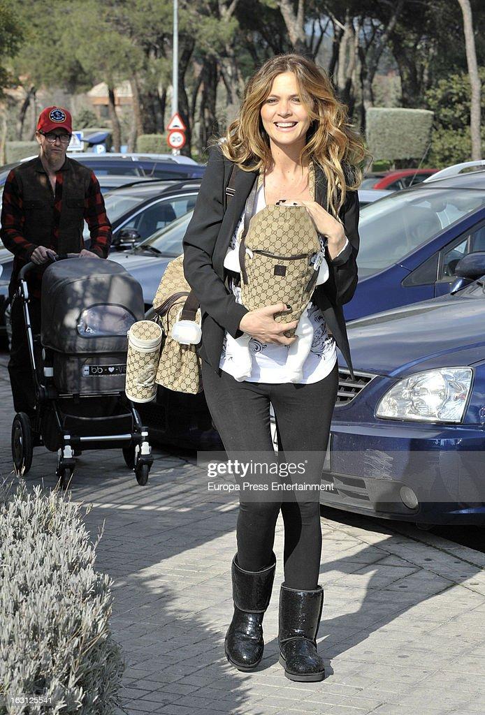 Spanish football player Jose Maria Gutierrez 'Guti''s girlfriend Romina Belluscio and her son Enzo are seen on February 20 2013 in Madrid Spain