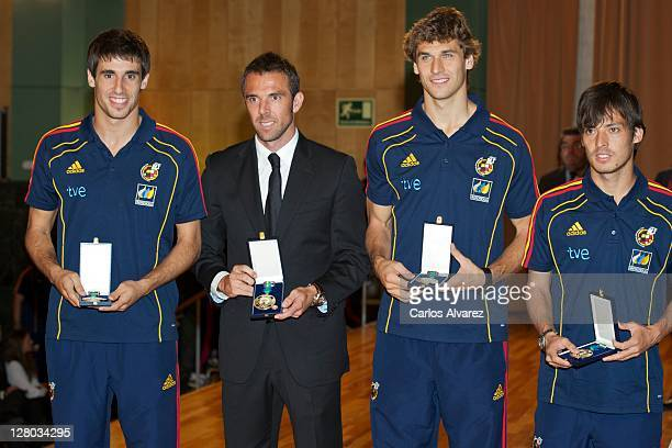 Spanish football team players Javi Martinez Carlos Marchena Fernando Llorente and David Silva pose for the photographers during 'Real Orden del...