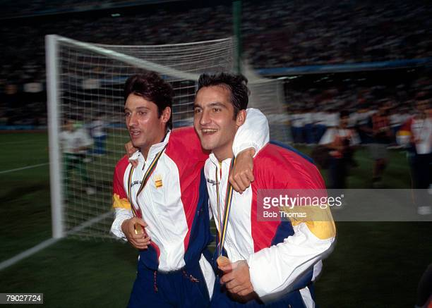 Spanish footballer Roberto Solozabel and Antonio Pinilla celebrate with their gold medals after beating Poland 3 2 in the final of the football...