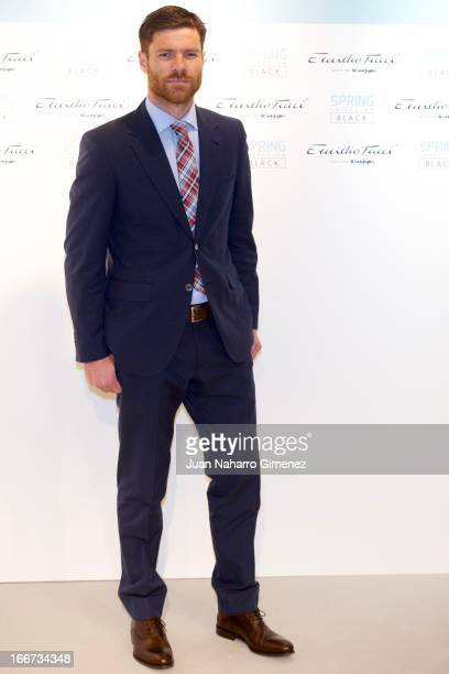Spanish footballer Xavi Alonso of Real Madrid team attends a presentation of 'Coleccion Black' of Emilio Tucci at El Corte Ingles on April 16 2013 in...