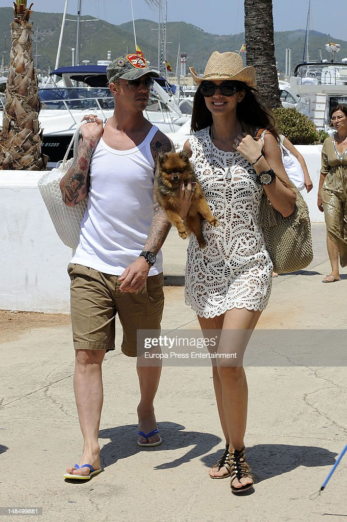 Spanish footballplayer Guti and his girlfriend Romina Belluscio several months pregnant are seen on a yacht on July 2 2012 in Ibiza Spain