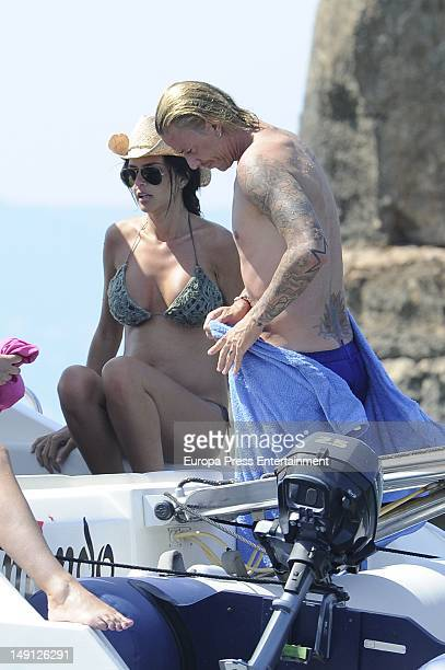Spanish footballplayer Guti and his girlfriend Romina Belluscio several months pregnant are seen on a yacht on July 21 2012 in Ibiza Spain