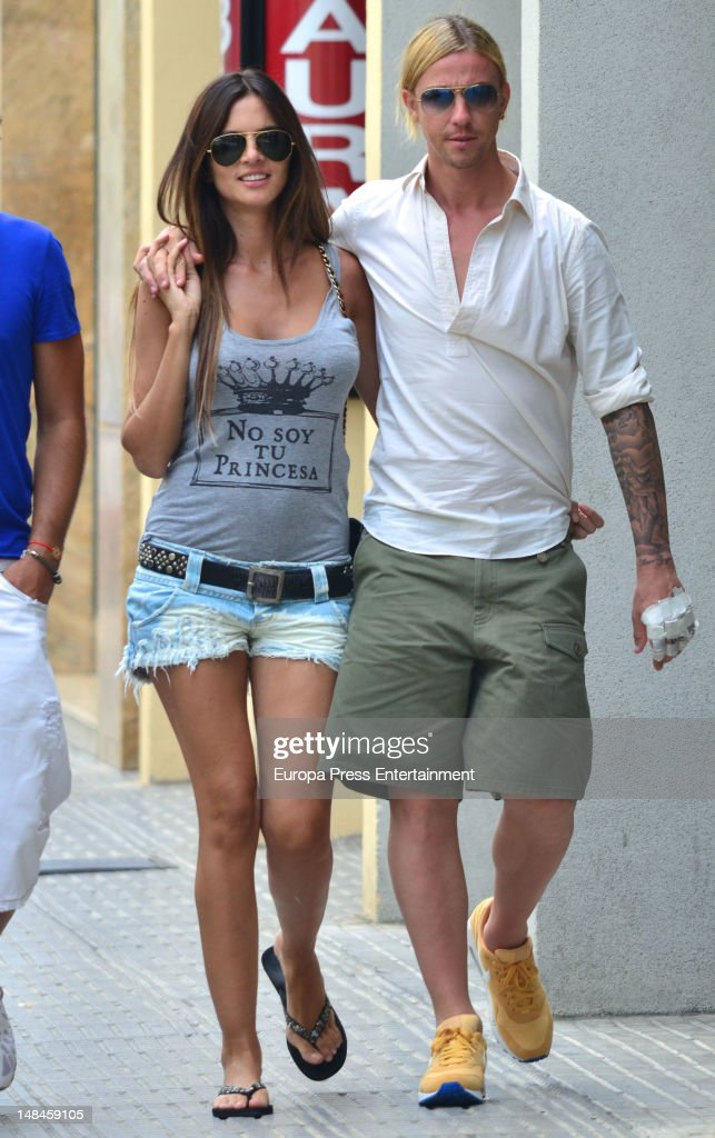 Spanish footballplayer Guti pictured with Romina Belluscio has her name tattooed on his fingers on July 16 2012 in Ibiza Spain