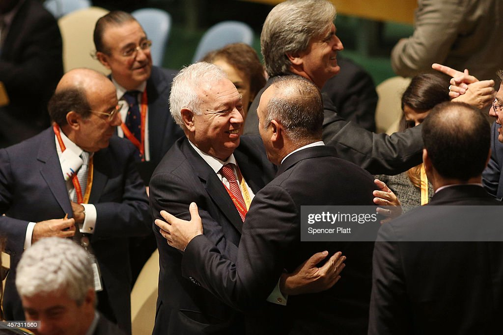 Spanish Foreign Minister Jose Manuel GarcaMargallo receives a hug from Turkish Foreign Minister Mevlut Cavusoglu after beating out Turkey for a seat...