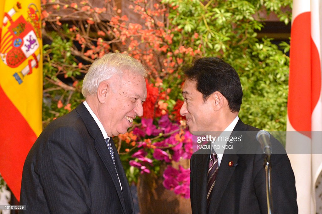 Spanish Foreign Minister Jose Manuel Garcia-Margallo (L) and his Japanese counterpart Fumio Kishida (R) share a light moment following their talks at the Iikura guest house in Tokyo on February 13, 2013. Garcia-Margallo is on a five-day visit to Japan through February 16.