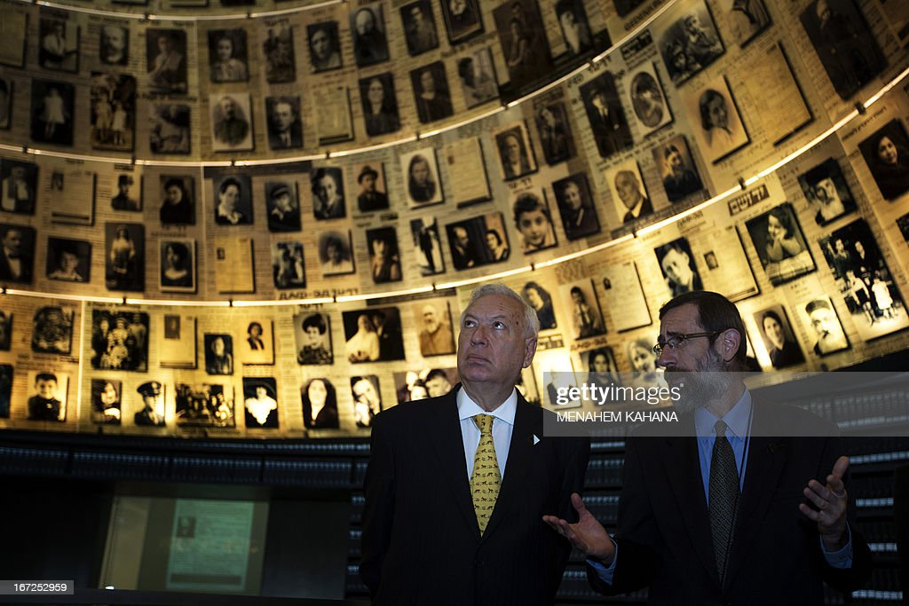 Spanish Foreign Minister, Jose Manuel Garcia-Margallo (L) is given a tour by a guide Alexander Abrahim of the Hall of Names at the Yad Vashem Holocaust memorial, which commemorates the six million Jews killed by the Nazis during World War II, in Jerusalem on April 23, 2013.