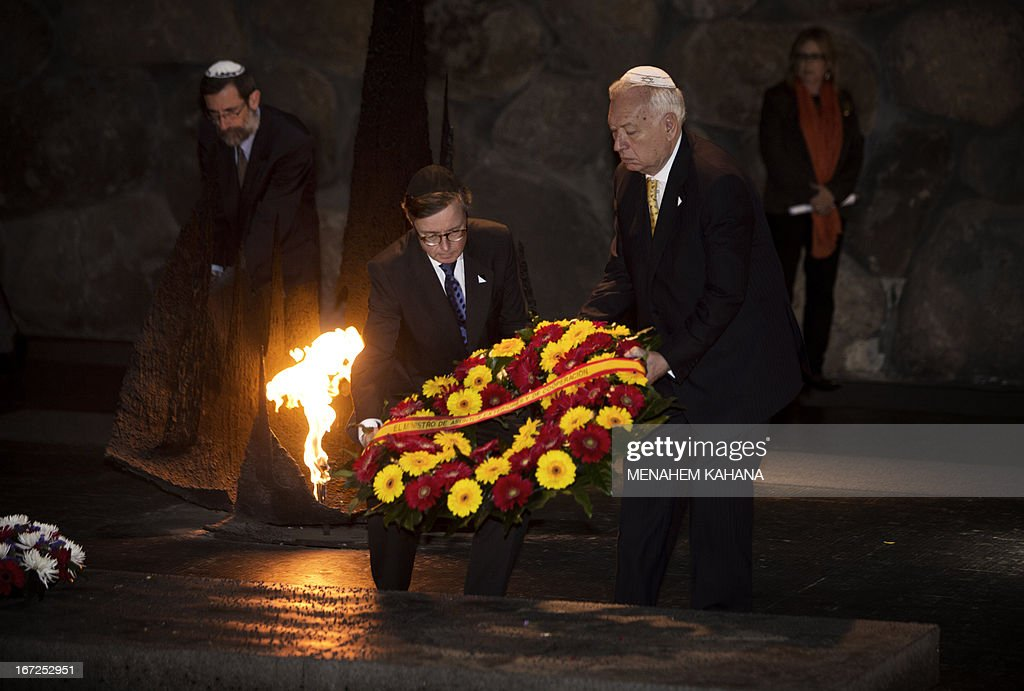 Spanish Foreign Minister, Jose Manuel Garcia-Margallo (R) lays a wreath in the Hall of Remembrance during a visit to the Yad Vashem Holocaust memorial, which commemorates the six million Jews killed by the Nazis during World War II, in Jerusalem on April 23, 2013.