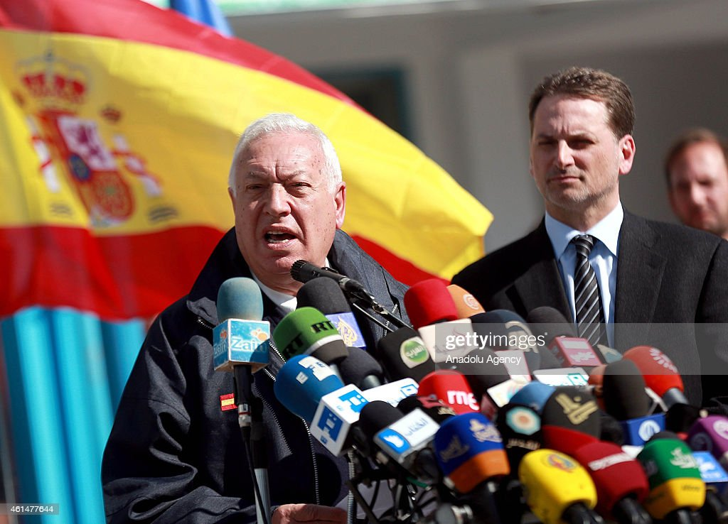 Spanish Foreign Minister Jose Manuel Garcia-Margallo (L) speaks to the press during his visit to UNRWA Al Zaitun Elementary School in Gaza City, Gaza on January 13, 2015.