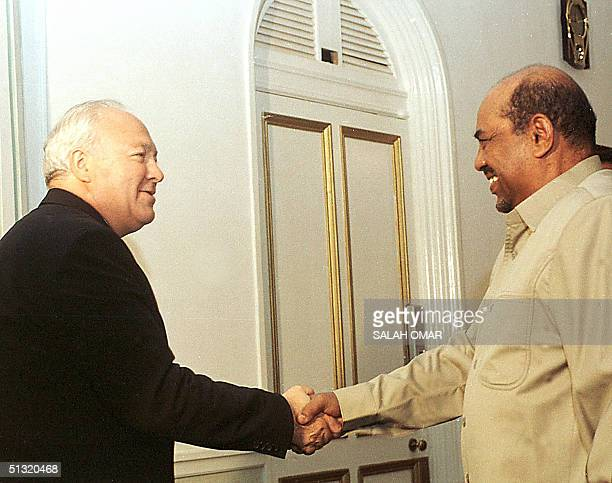 Spanish Foreign Minister Miguel Angel Moratinos shakes hands with President Omar alBeshir in Khartoum 18 September 2004 Moratinos held talks with...
