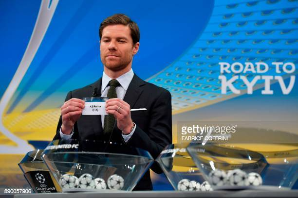 Spanish former international Xabi Alonso shows the slip of AS Roma during the draw for the round of 16 of the UEFA Champions League football...