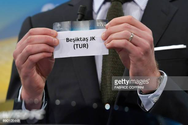 Spanish former international Xabi Alonso shows the slip of Besiktas JK during the draw for the round of 16 of the UEFA Champions League football...