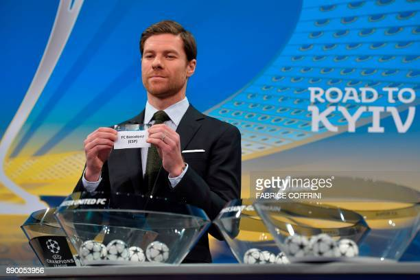 Spanish former international Xabi Alonso shows the slip of FC Barcelona during the draw for the round of 16 of the UEFA Champions League football...
