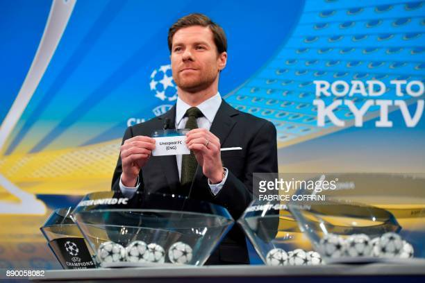 Spanish former international Xabi Alonso shows the slip of Liverpool FC during the draw for the round of 16 of the UEFA Champions League football...