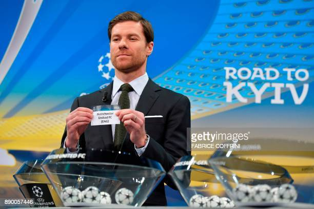 Spanish former international Xabi Alonso shows the slip of Manchester United during the draw for the round of 16 of the UEFA Champions League...