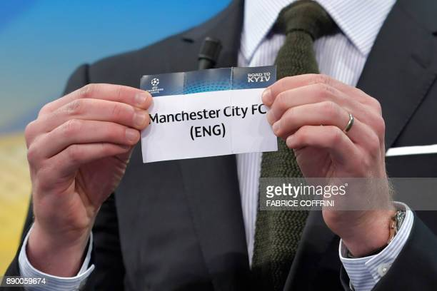 Spanish former international Xabi Alonso shows the slip of Manchester City during the draw for the round of 16 of the UEFA Champions League football...