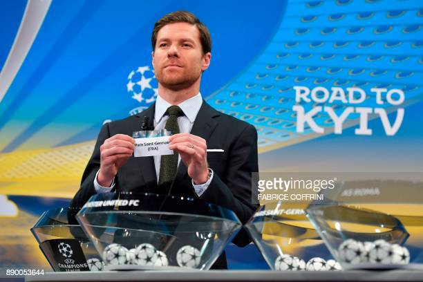 Spanish former international Xabi Alonso shows the slip of Paris SaintGermain during the draw for the round of 16 of the UEFA Champions League...