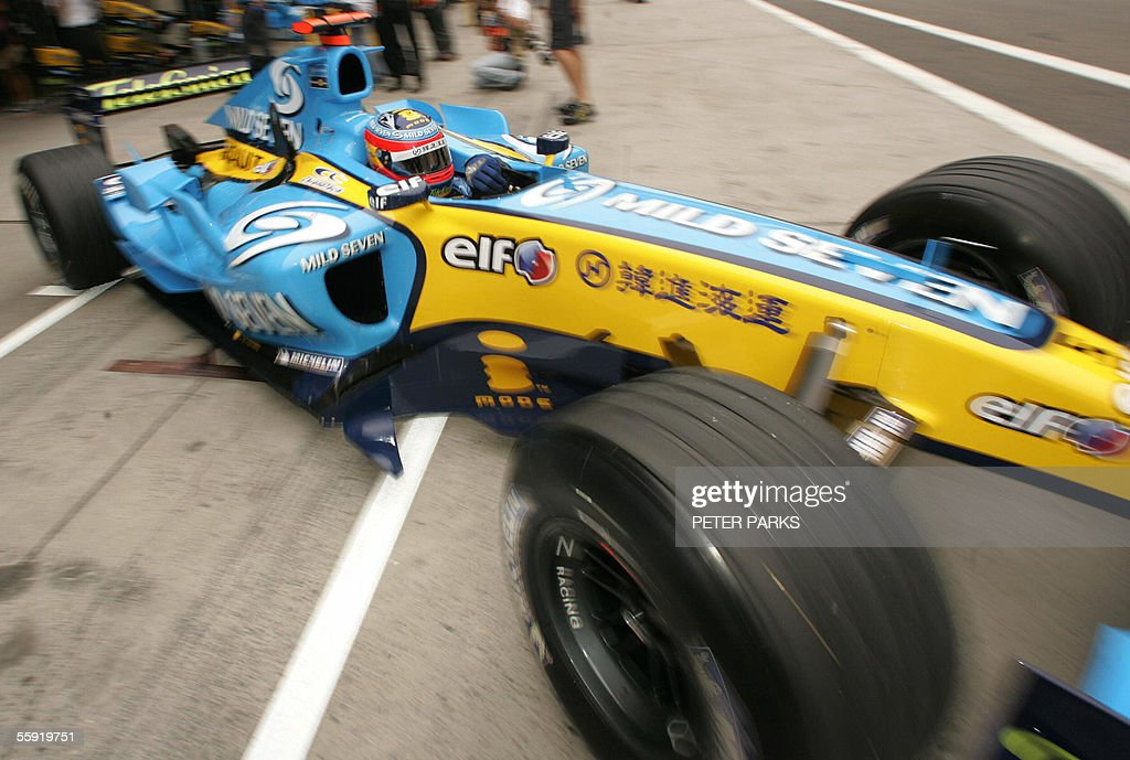 Spanish Formula One driver and World Champion Fernando Alonso of the Renault team leaves the pits during the second free practise session of the...