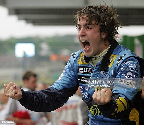 Spanish Formula One driver Fernando Alonso of Renault celebrates his World Champion title after arriving third in the Brazilian F1 GP 25 September...