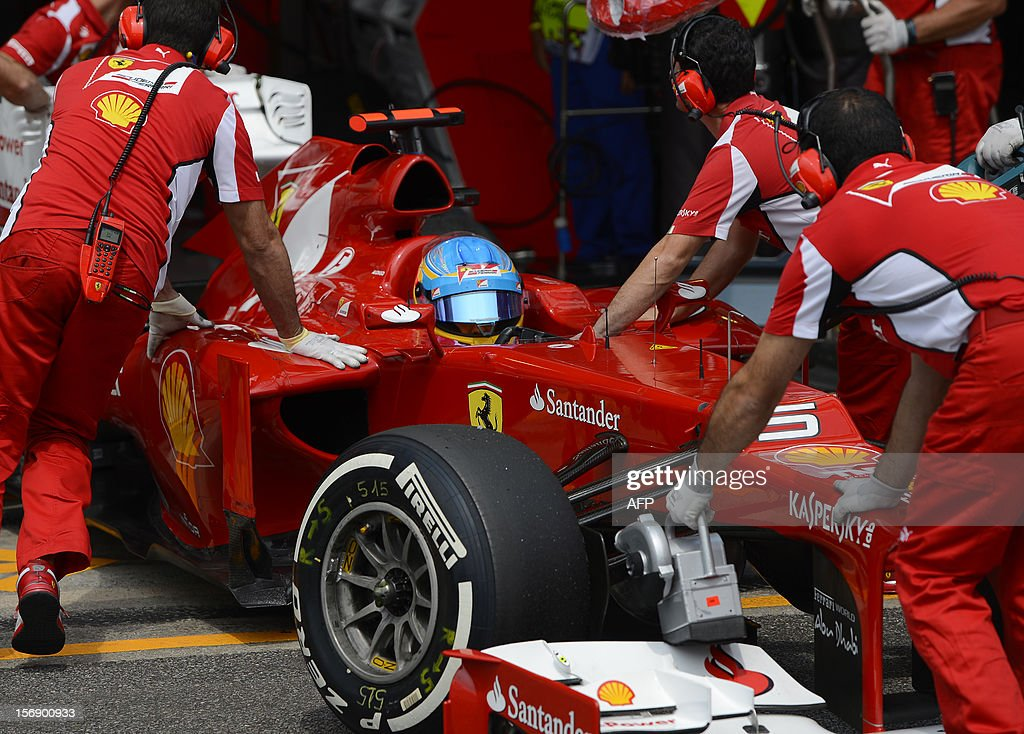 Spanish Formula One driver Fernando Alonso returns to the Ferrari pits during the qualifying session for the Brazilian GP on Sunday, during the qualifying at the Interlagos racetrack in Sao Paulo, Brazil on November 24 , 2012 . AFP PHOTO YASUYOSHI CHIBA/ POOL