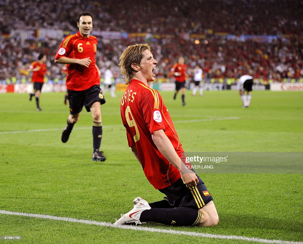 Spanish forward <a gi-track='captionPersonalityLinkClicked' href=/galleries/search?phrase=Fernando+Torres&family=editorial&specificpeople=194755 ng-click='$event.stopPropagation()'>Fernando Torres</a> (R) celebrates in front of midfielder teammate Andres Iniesta after scoring the opening goal during the Euro 2008 championships final football match Germany vs. Spain on June 29, 2008 at Ernst-Happel stadium in Vienna, Austria. Spain leads 1-0.